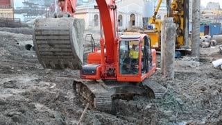 UKRAINE, KIEV, AUGUST 5, 2013: Red excavator on a construction site. Drilling wells for bored piles