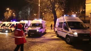 UKRAINE, KIEV, JANUARY 19, 2014: Thousands of anti-government protesters clashed with riot police, burning police buses and attacking with stones, sticks and fires after tough laws were passed. Ambulance cars