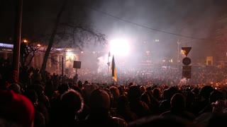 UKRAINE, KIEV, JANUARY 19, 2014: Thousands of anti-government protesters clashed with riot police, burning police buses and attacking with stones, sticks and fires after tough laws were passed.