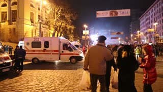 UKRAINE, KIEV, JANUARY 19, 2014: Thousands of anti-government protesters clashed with riot police,burning police buses and attacking with stones,sticks and fires after tough laws were passed.Ambulance