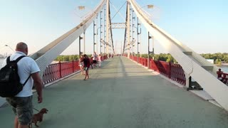UKRAINE, KIEV, JULY 16, 2014: People on the pedestrian bridge in Kiev, Ukraine