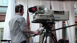 UKRAINE, KIEV, JULY 27, 2014: Videotape operator with big camera at work
