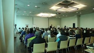 UKRAINE, KIEV, MARCH 16, 2014: People at business seminar inside big hall in Kiev, Ukraine