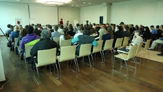 UKRAINE, KIEV, MARCH 16, 2014: People at business seminar inside big hall in Kiev, Ukraine.