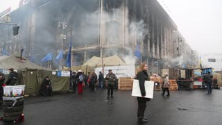UKRAINE, KIEV, MARCH 4, 2014: Political crisis. People near burnt down building of trade union and barricades on the Khreshchatyk street - main street of Kiev, Ukraine, March 4, 2014