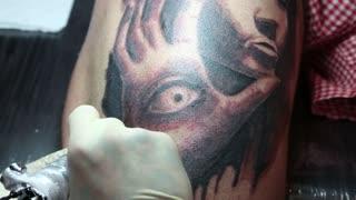 "UKRAINE, KIEV, MAY 10, 2013: People make a tattoos at the 9-th international tattoo festival ""Tattoo Collection 2013"" in Kiev, Ukraine."