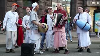 UKRAINE, KIEV, MAY 25, 2013: Hare Krishna devotees playing musical instruments, dancing and singing on the main street in Kiev, Ukraine