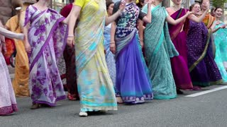 UKRAINE, KIEV, MAY 25, 2013: Women in Hindu traditional colorful costumes dancing and singing Hare Krishna mantra on the main street of Kiev, Ukraine, May 25, 2013