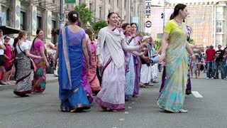 UKRAINE, KIEV, MAY 25, 2013: Women in Hindu traditional colorful costumes, dancing on the main street in Kiev, Ukraine