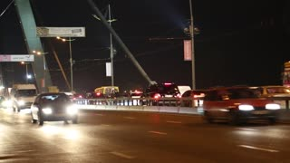 UKRAINE, KIEV, OCTOBER 19, 2012: Road traffic in nighttime on the Moscow bridge in Kiev, Ukraine (video with stereo sound)