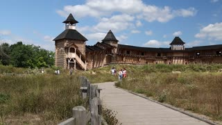 UKRAINE, KIEV REGION, KOPACHIV VILLAGE, AUGUST 14, 2016: People at cultural and entertainment event in Kyivan Rus park in Kopachiv village, historical reconstruction of ancient Kiev, wooden fortress