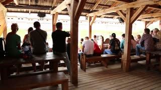 UKRAINE, KIEV REGION, KOPACHIV VILLAGE, AUGUST 14, 2016: People at cultural and entertainment festival in Kyivan Rus park in Kopachiv village, historical reconstruction of ancient Kiev, audience