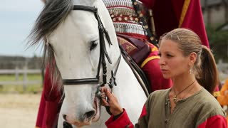 UKRAINE, KIEV REGION, KOPACHIV VILLAGE, AUGUST 14, 2016: People at cultural and entertainment festival in Kyivan Rus park in Kopachiv village, historical reconstruction of ancient Kiev, horse in arena