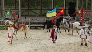 UKRAINE, KIEV REGION, KOPACHIV VILLAGE, AUGUST 14, 2016: People at cultural and entertainment festival in Kyivan Rus park in Kopachiv village, historical reconstruction of ancient Kiev,horses in arena