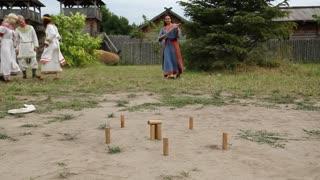 UKRAINE, KIEV REGION, KOPACHIV VILLAGE, AUGUST 14,2016: Historical reconstruction of ancient Kiev, actors plays gorodki, game similar to skittles
