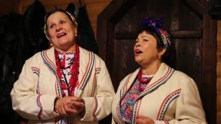 UKRAINE, KIEV, SEPTEMBER 7, 2013: Ukrainian folk song. Women in ukrainian traditional costume sing ukrainian song, Kiev, Ukraine, September 7, 2013