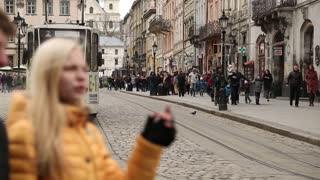 UKRAINE, LVIV, APRIL 5, 2015: Green tram and people on the Market Square - is a central square of the city of Lviv in Western Ukraine