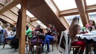 UKRAINE, LVIV, APRIL 5, 2015: People inside coffee and pastry bar in Lviv, Ukraine