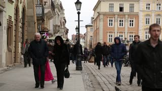 UKRAINE, LVIV, APRIL 5, 2015: People on the Market Square - is a central square of the city of Lviv in Western Ukraine