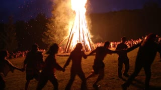 UKRAINE, PYLYPETS VILLAGE, JULY 6,2015: People near the bonfire celebrate the feast of Ivan Kupala Day or Kupala Night-folk festival of the Eastern Slavs.This festival dedicated to the summer solstice