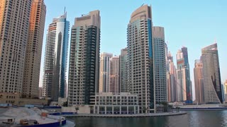 United arab emirates. Dubai. Dubai Marina - the largest man-made marina in the world. Dubai Marina - is a district in the heart of what has become known as New Dubai. Dubai Marina is a canal city carved along a 3 km stretch of Persian Gulf shoreline.