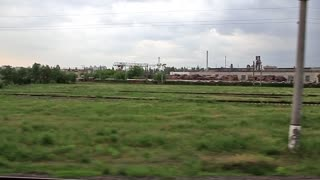 Video filming of industrial area from moving train 720p, 59.94fps