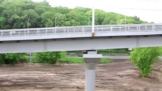 Video filming of new bridge construction from moving train 720p, 59.94fps