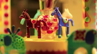 11861Colorful caramel animals in sweets shop. Horses on the merry-go-round in candy store. Animals in shop window in confectionery