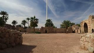 Aqaba fort near flag of the Arab Revolt in Aqaba, Jordan. Aqaba Castle, Mamluk Castle or Aqaba Fort, adjacent to fort is archaeological museum. Aqaba - only coastal city in Hashemite Kingdom of Jordan