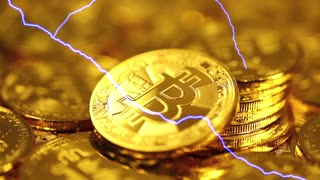 Blockchain technology, Bitcoins mining concept with lightning, macro shot of bitcoins. Cryptocurrency Bitcoin, BTC, coins rotates, power consumption concept