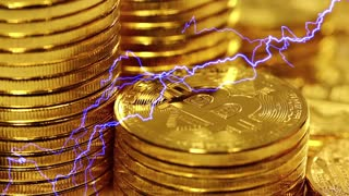 Blockchain technology, Bitcoins mining concept with lightning, macro shot of bitcoins. Cryptocurrency Bitcoin, BTC, power consumption concept