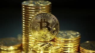 Crypto currency, bitcoin on a dark background with flashing lights  BTC,  Bit Coin  Blockchain technology, bitcoin mining  Macro shot of rotating