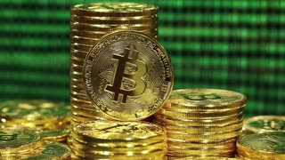 Crypto currency Gold Bitcoin, BTC, Bit Coins. Block chain technology, bitcoin mining concept, monitor at background