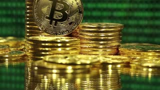Crypto currency Gold Bitcoin, BTC, Bit Coins. Block chain technology, bitcoin mining concept, monitor with green code at background