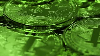 Cryptocurrency Bitcoin, BTC, Bit coins rotates in green light. Blockchain technology, bitcoin mining concept, macro shot of bitcoins