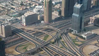 Dubai downtown traffic, United Arab Emirates. View on junction and Sheikh Zayed road from the 124th floor of Burj Khalifa skyscraper in Dubai, currently the tallest structure in the world, 829 m