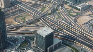 Dubai downtown traffic, United Arab Emirates. View on junction and Sheikh Zayed road from the 124th floor of Burj Khalifa skyscraper in Dubai, currently the tallest structure in the world