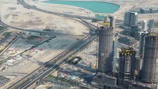 Dubai downtown, United Arab Emirates. View from the 124th floor of Burj Khalifa skyscraper in Dubai. At the top - Burj Khalifa. Dubai is a city and emirate in UAE