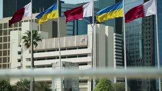 Flags of Qatar and Ukraine in financial centre, Doha, Qatar