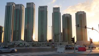 Green skyscrapers on Al reem island in Abu Dhabi - capital and second most populous city in United Arab Emirates, after Dubai, and also capital of Abu Dhabi emirate, largest of seven emirates in UAE