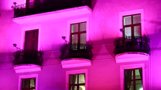 House with night illumination that change color. Pink, purple, violet, blue, red, orange, yellow, green colors