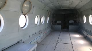 Interior of helicopter. Inside the helicopter. Empty interior of old helicopter. Interior of helicopter without passenger seats