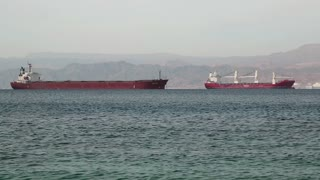 JORDAN, AQABA, DECEMBER 10, 2016: Freight vessels in Red Sea, Gulf of Aqaba near Aqaba city, Hashemite Kingdom of Jordan