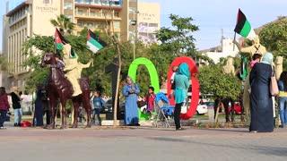 JORDAN, AQABA, DECEMBER 16, 2016: People near monument to the centennial of the Great Arab Revolt, Ayla Square in Aqaba, Jordan, officially The Hashemite Kingdom of Jordan