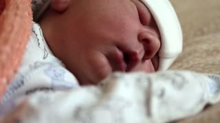 Newborn baby sleeps. Little 4 days old newborn boy lies in cot in maternity hospital. Asleep newborn baby boy