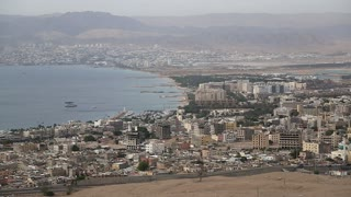 Panorama of Aqaba city in Jordan and Eilat city in Israel. View from mountain in Aqaba city in Jordan. Two city and two country in one video clip
