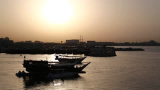 Panorama view of harbour at evening in old town of Doha - capital and most populous city in Qatar, Persian Gulf, Arabian Peninsula