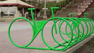 Parking of bicycles on the street of city. Cycle parking rack, outdoor parking place for bicycles