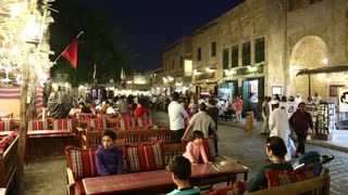 People at restaurant in Souq Waqif, eastern market in Doha city, Qatar