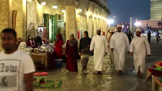People at Souq Waqif, eastern bazaar in Doha, Qatar
